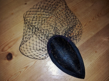 Birdcage veil attached to teardrop fascinator base