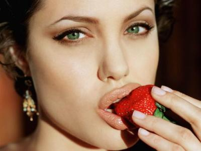 Angelina Jolie Eats Fruit