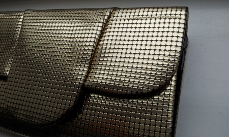 Vintage 1980's gold clutch handbag