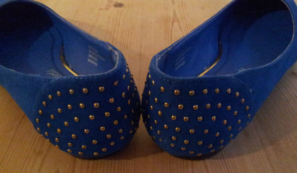Back of blue ballet pumps